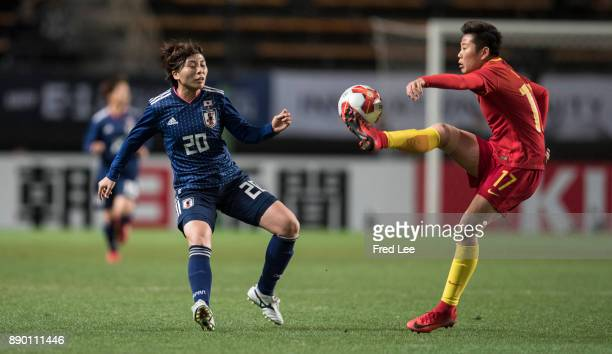 Li ying of China and Manya Miho of Japan in action during the EAFF E1 Women's Football Championship between Japan and China at Fukuda Denshi Arena on...