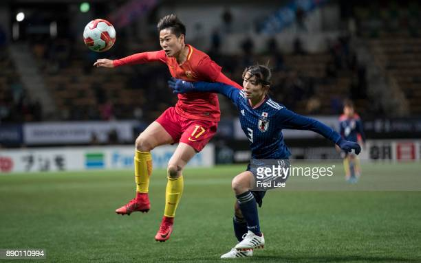 Li ying of China and Sameshima Aya of Japan in action during the EAFF E1 Women's Football Championship between Japan and China at Fukuda Denshi Arena...