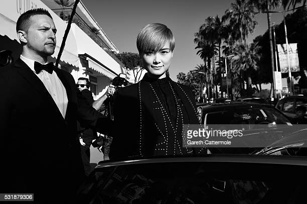 Li Yuchun departs the Martinez Hotel during the 69th annual Cannes Film Festival on May 15 2016 in Cannes France