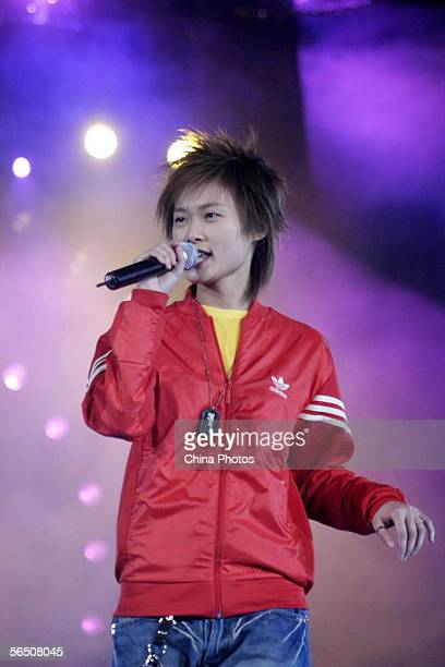 Li Yuchun winner of the 'Super Girl Voice' TV Show performs during the New Year concert held by Hunan Province Satellite Television Station on...