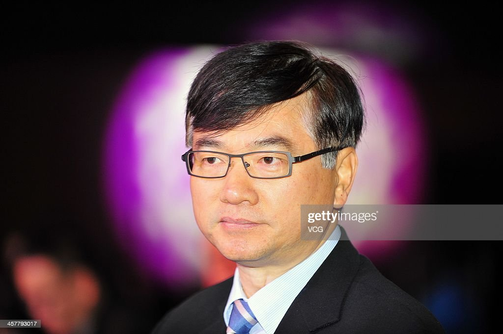Li Yue, Chief Executive Officer of China Mobile Limited, looks on during the China Mobile Global Partner Conference 2013 at Poly World Trade Center on December 18, 2013 in Guangzhou, China. China Mobile received fourth-generation (4G) mobile licences on December 4, and it has spent more than 40 billion yuan (6.6 billion US dollars) this year into building its fourth-generation network.