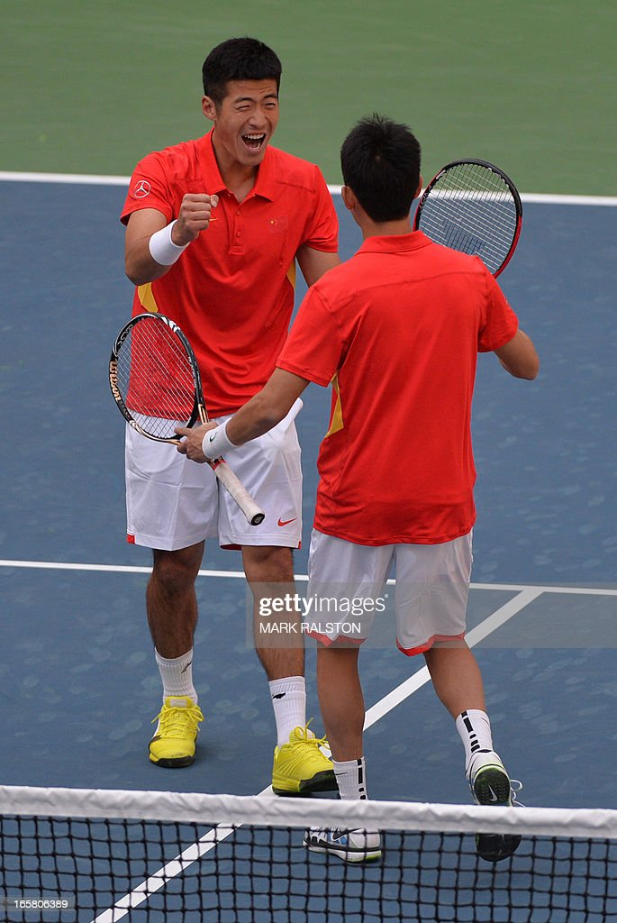 Li Zhe (L) and Gong Maoxin (R) of China celebrate after beating Huang Liang-Chi and Yang Tsung-Hua of Taiwan in their Davis Cup first round play-off doubles tennis match at the Tianjin Tennis Center on April 6, 2013. The Chinese pair won 6-3, 6-3, 4-6, 6-3 to give China an unbeatable 3-0 lead. AFP PHOTO / Mark RALSTON