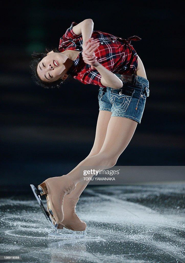 Li Zijun of China performs during an exhibition in the NHK Trophy, the last leg of the six-stage ISU figure skating Grand Prix series, in Rifu, northern Japan, on November 25, 2012. AFP PHOTO/Toru YAMANAKA