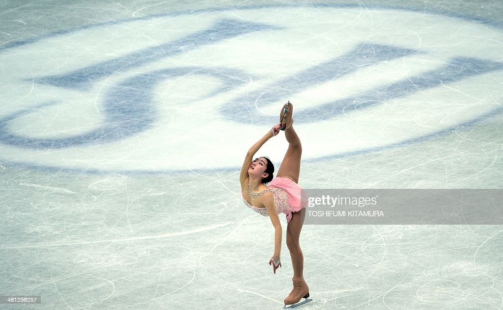 Li Zijun of China performs during her free skating in the women's singles at the world figure skating championships in Saitama on March 29, 2014. AFP PHOTO / TOSHIFUMI KITAMURA