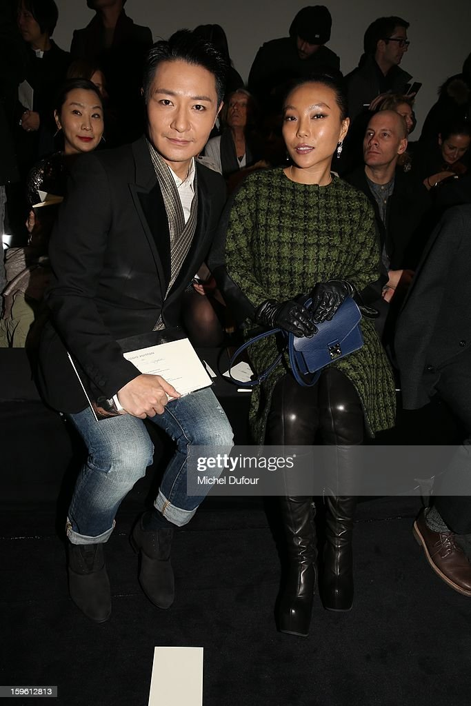 Li Zonghan and Wan BaoBao attend the Louis Vuitton Men Autumn / Winter 2013 show as part of Paris Fashion Week on January 17, 2013 in Paris, France.