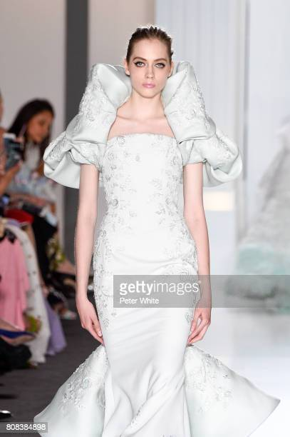Lia Pavlova walks the runway during the Ralph Russo Haute Couture Fall/Winter 20172018 show as part of Haute Couture Paris Fashion Week on July 3...