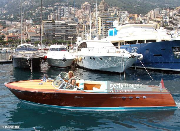 Lia Riva Ferrares daughter of Carlo Riva rides a Riva speedboat icon of the Made in Italy luxury design in the Monaco harbor on July 11 2011 Like...
