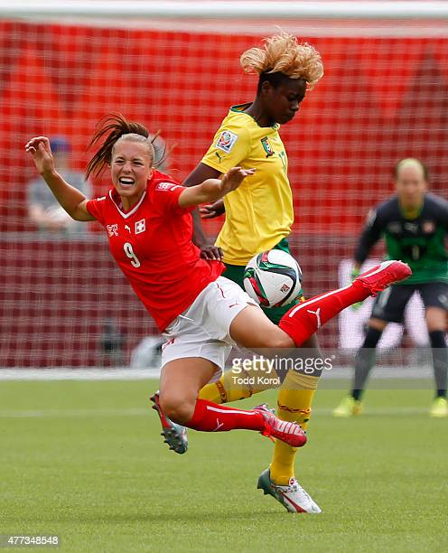 Lia Waelti of Switzerland gets knocked down by Gaelle Enganamouit of Cameroon during the FIFA Women's World Cup Canada Group C match between...