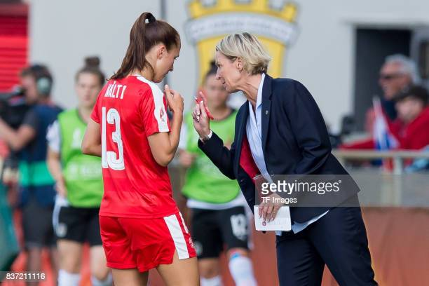 Lia Waelti of Switzerland speak with Head coach Martina VossTecklenburg of Switzerland during the Group C match between Austria and Switzerland...