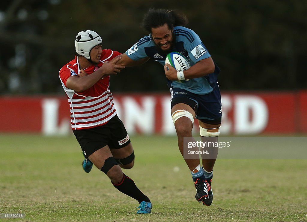 Liaki Moli of the Blues fends off Hayato Nishiuchi of Japan during the Pacific Rugby Cup match between the Blues Development and Junior Japan at Bell Park on March 28, 2013 in Auckland, New Zealand.