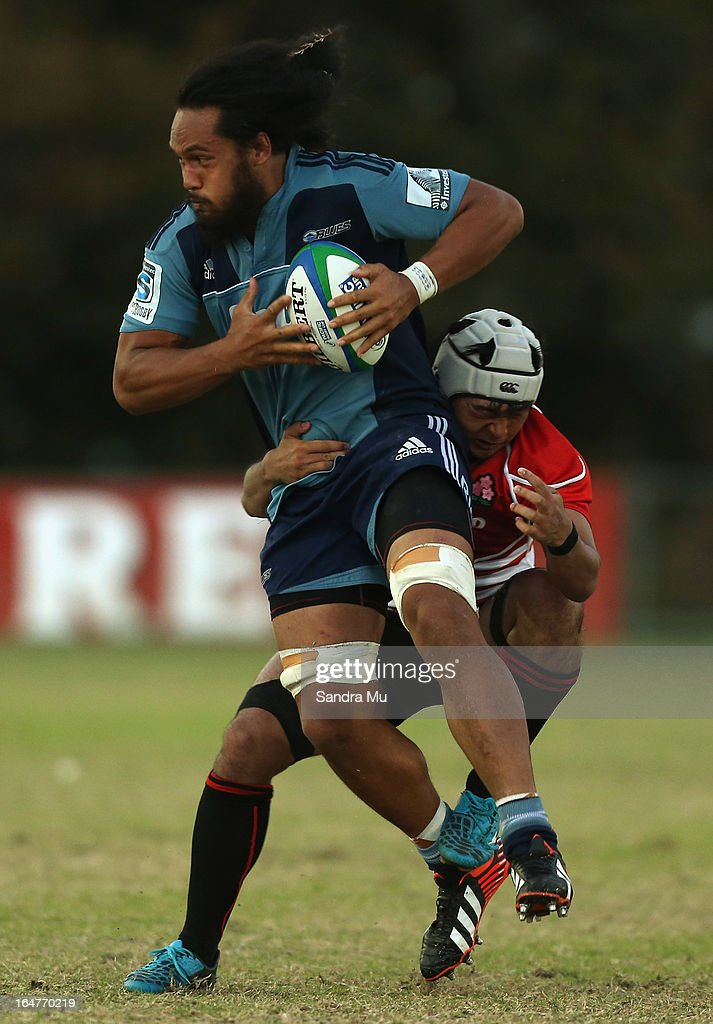 Liaki Moli of the Blues is tackled by Hayato Nishiuchi of Japan during the Pacific Rugby Cup match between the Blues Development and Junior Japan at Bell Park on March 28, 2013 in Auckland, New Zealand.
