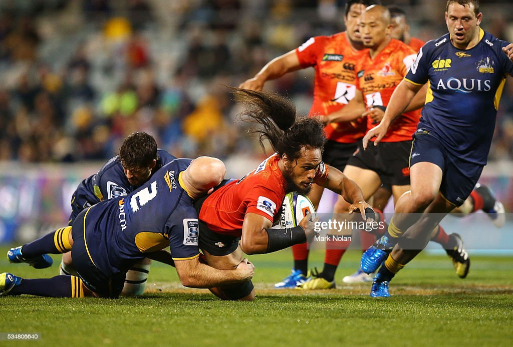 <a gi-track='captionPersonalityLinkClicked' href=/galleries/search?phrase=Liaki+Moli&family=editorial&specificpeople=7050184 ng-click='$event.stopPropagation()'>Liaki Moli</a> of the Sunwolves is tackled during the round 14 Super Rugby match between the Brumbies and the Sunwolves at GIO Stadium on May 28, 2016 in Canberra, Australia.
