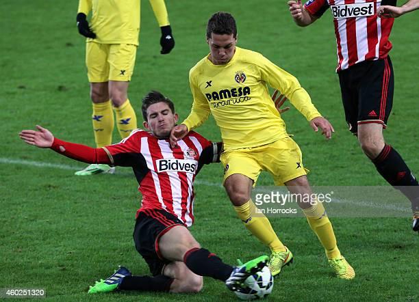 Liam Agnew of Sunderland tackles Manuel Viana of Villarreal during the Premier League International Cup match between Sunderland U21 and Villarreal...