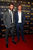 Liam and Chris Hemsworth arrive ahead of the Australian premiere of 'The Dressmaker' on October 18 2015 in Melbourne Australia