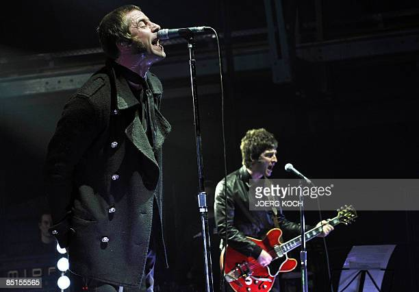 Liam and Noel Gallagher of the band Oasis perform on stage in the southern German city of Munich on February 27 2009 Oasis are touring around Europe...