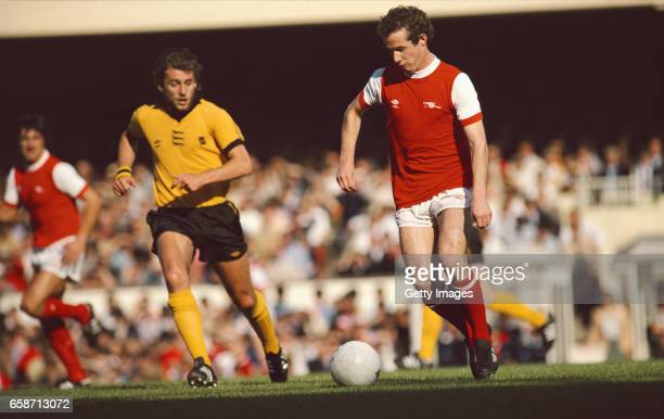 Liam Brady of Arsenal in action watched by Peter Daniel of Wolves during a First Division Match at Highbury on September 29 1979 in London England