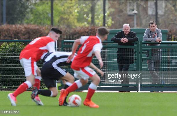 Liam Brady the former Arsenal player and Luke Hobbs the Arsenal Academy Manager watch the action during Arsenal and Juventus in the Liam Brady Cup on...