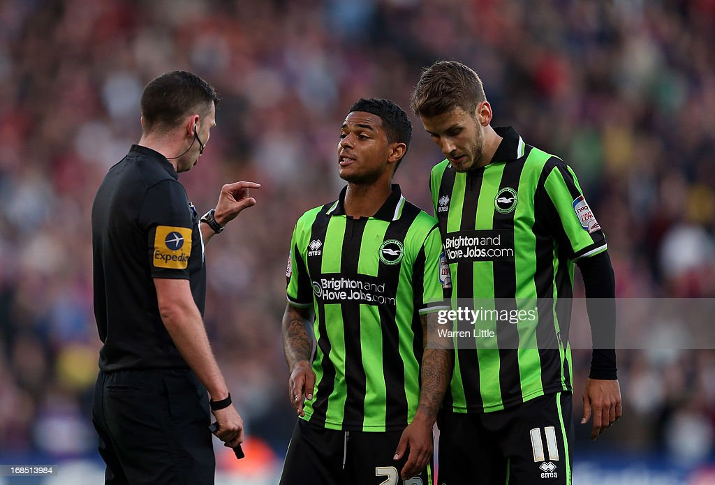 Liam Bridcutt of Brighton & Hove Albioin is spoken to by Refree Mr M. Oliver during the npower Championship play off semi final first leg at Selhurst Park on May 10, 2013 in London, England.