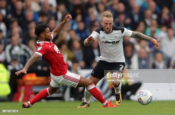 Liam Bridcutt of Nottingham Forest and Johnny Russell of Derby County during the Sky Bet Championship match between Derby County and Nottingham...