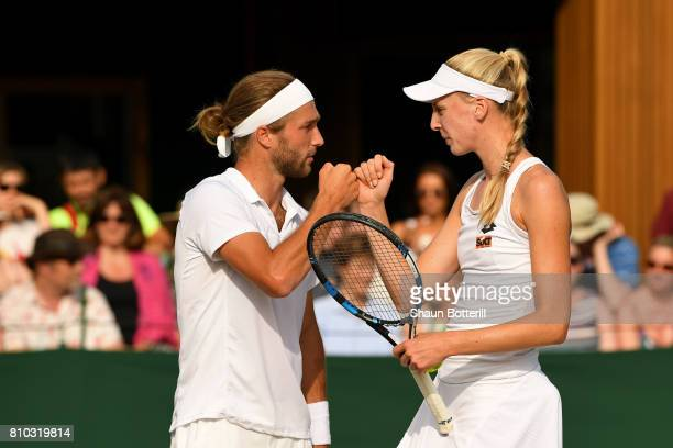 Liam Broady and Naomi Broady of Great Britain celebrate during the Mixed Doubles first round match against Wesley Koolhof of the Netherlands and Demi...