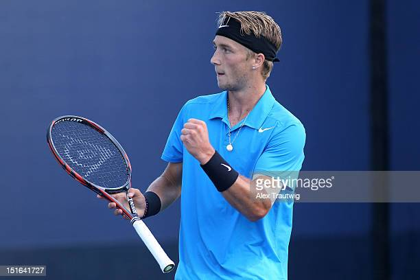Liam Broady of Great Britain celebrates a point during his boys' singles final match against Filip Peliwo of Canada on Day Fourteen of the 2012 US...