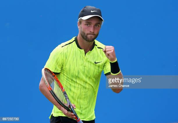 Liam Broady of Great Britain celebrates during the qualifying match against Denis Shapovalov of Canada ahead of the Aegon Championships at Queens...