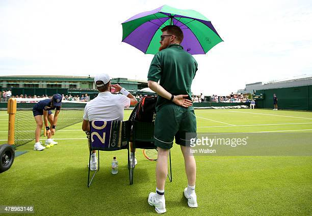 Liam Broady of Great Britain during a break against Marinko Matosevic of Australia in their Gentlemen's Singles match during day one of the Wimbledon...