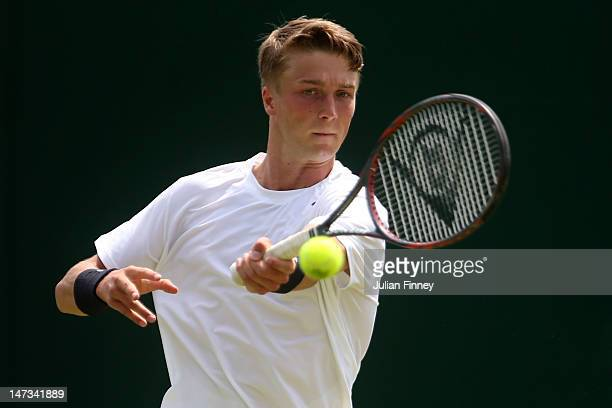 Liam Broady of Great Britain in action while playing with Oliver Golding of Great Britain during their Gentlemen's Doubles first round match against...