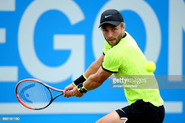 Liam Broady of Great Britain plays a backhand during his first round match against Illya Marchenko of Ukraine during day one of the Aegon Open at...