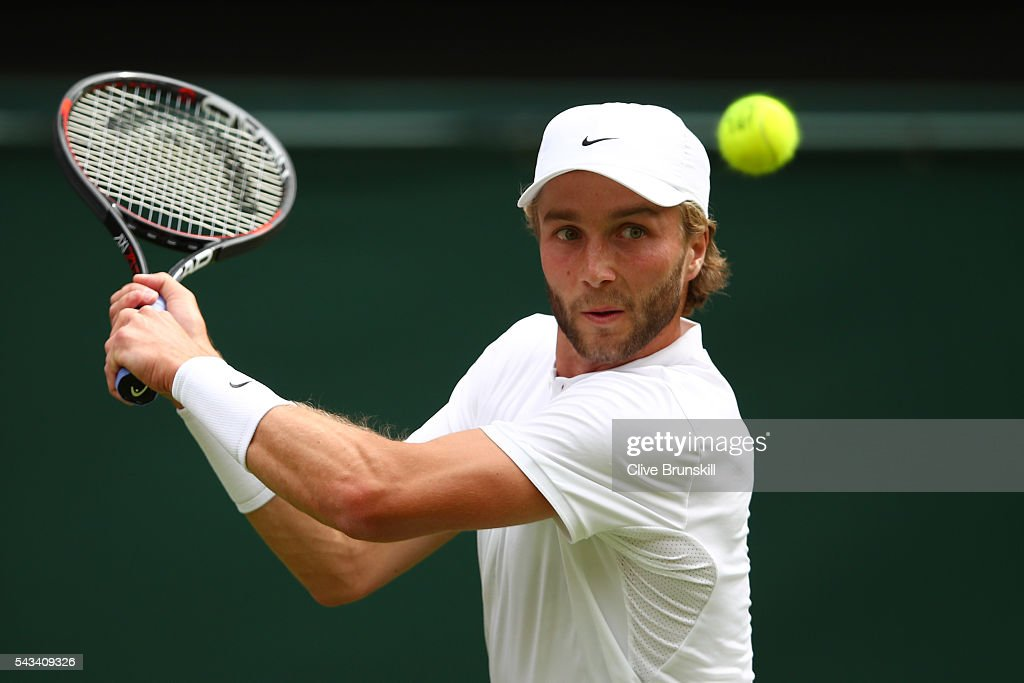 <a gi-track='captionPersonalityLinkClicked' href=/galleries/search?phrase=Liam+Broady&family=editorial&specificpeople=5946969 ng-click='$event.stopPropagation()'>Liam Broady</a> of Great Britain plays a backhand during the Men's Singles first round match against Andy Murray of Great Britain on day two of the Wimbledon Lawn Tennis Championships at the All England Lawn Tennis and Croquet Club on June 28, 2016 in London, England.