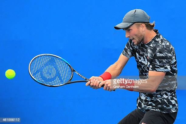 Liam Broady of Great Britain plays a backhand in his qualifying match against Jared Donaldson of the United States for the 2015 Australian Open at...