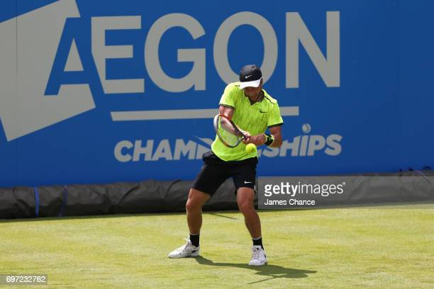 Liam Broady of Great Britain plays a backhand shot during the qualifying match against Denis Shapovalov of Canada ahead of the Aegon Championships at...