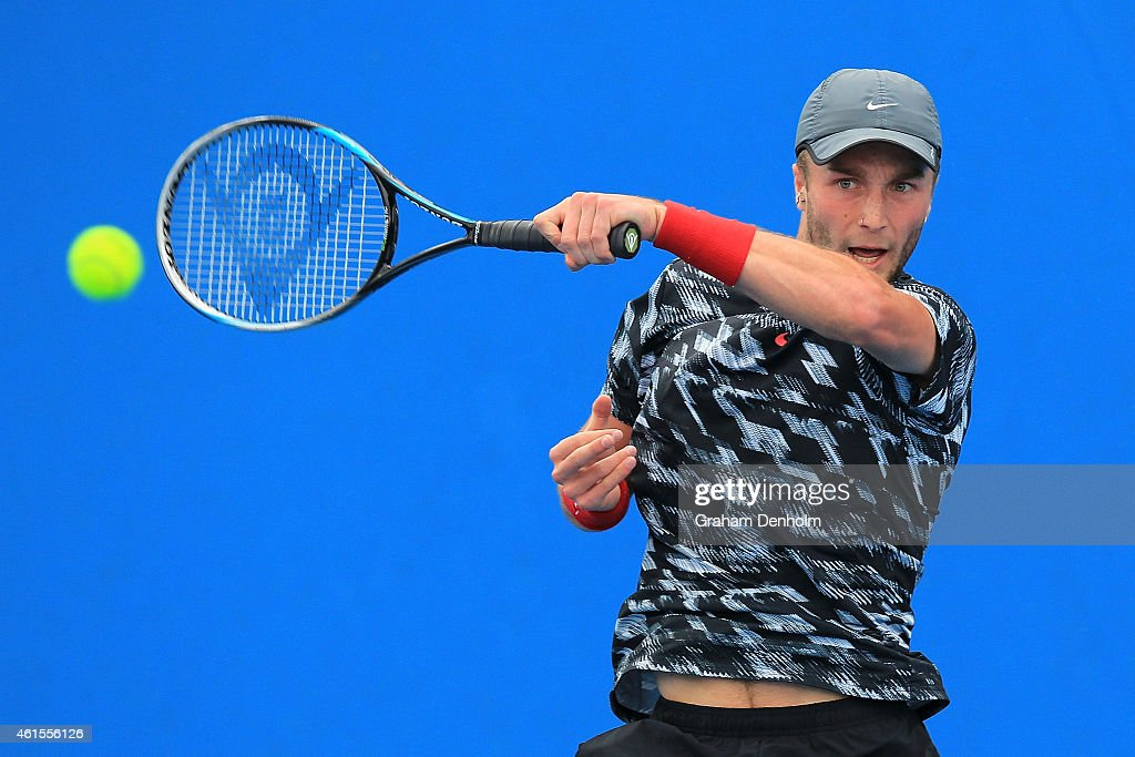 Liam Broady of Great Britain plays a forehand in his qualifying match against Jared Donaldson of the United States for the 2015 Australian Open at Melbourne Park on January 15, 2015 in Melbourne, Australia.