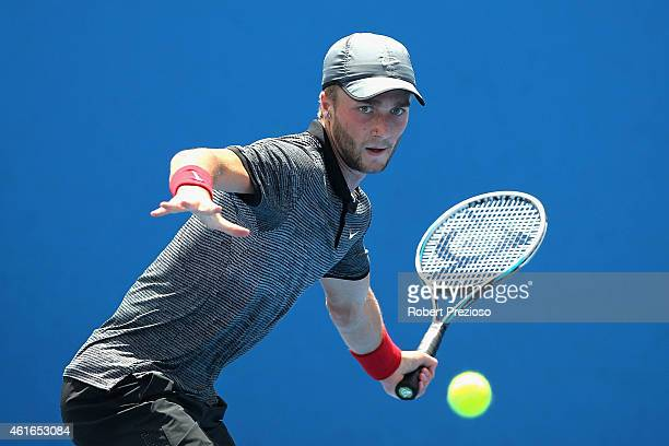 Liam Broady of Great Britain plays a forehand in his qualifying match against Michael Russell of USA for 2015 Australian Open at Melbourne Park on...