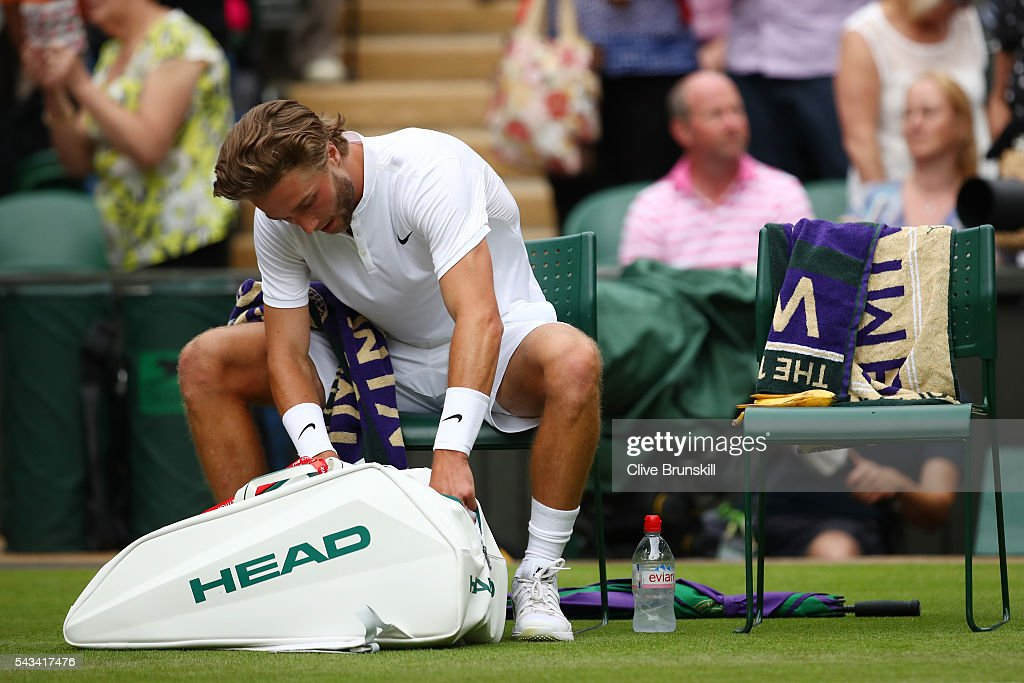 <a gi-track='captionPersonalityLinkClicked' href=/galleries/search?phrase=Liam+Broady&family=editorial&specificpeople=5946969 ng-click='$event.stopPropagation()'>Liam Broady</a> of Great Britain prepares to leave the court following defeat in the Men's Singles first round match against Andy Murray of Great Britain on day two of the Wimbledon Lawn Tennis Championships at the All England Lawn Tennis and Croquet Club on June 28, 2016 in London, England.
