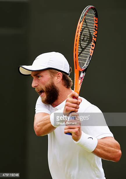 Liam Broady of Great Britain returns a shot in his Gentlemens Singles Second Round match against David Goffin of Belgium during day three of the...