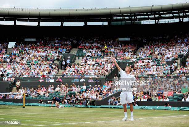 Liam Broady of Great Britain serves during his final round boy's match against Luke Saville of Australia on Day Twelve of the Wimbledon Lawn Tennis...