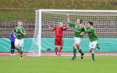 Liam Conlon of North Irland celebrates after scoring the first goal of his team while goalkeeper Paul Schuenemann of Germany reacts during the U16...