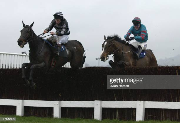 Liam Cooper and Joss Naylor lead the Tony McCoy ridden Tarxien over the last fence to land The Ian Williams Owners Novices Steeple Chase Race run at...