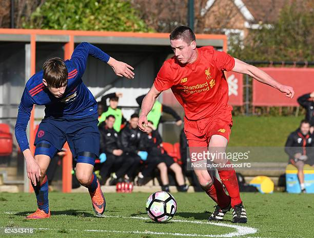 Liam Coyle of Liverpool and Callum Gribbin of Manchester United in action during the Liverpool v Manchester United U18 Premier League game at the...