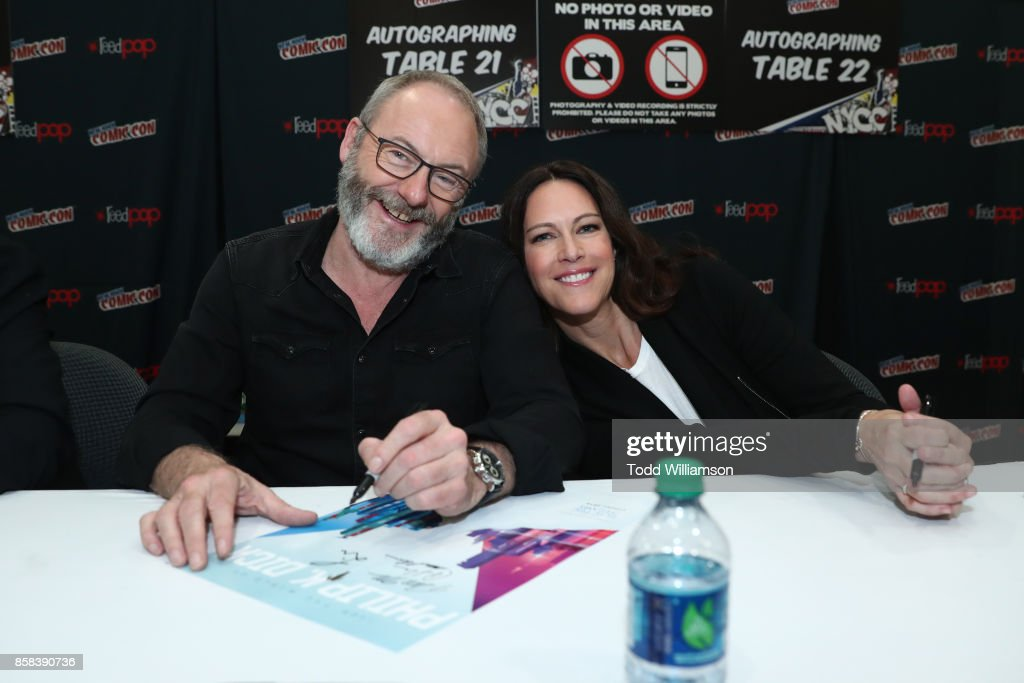 Liam Cunningham (L) and Isa Dick Hackett attend 'The World of Philip K. Dick' - The Man in the High Castle and Philip K. Dick's Electric Dreams Autograph Signing at The Jacob K. Javits Convention Center on October 6, 2017 in New York City.