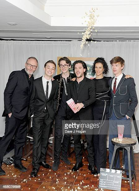 Liam Cunningham DeanCharles Chapman Isaac HempsteadWright Kit Harington Indira Varma and Thomas BrodieSangster winners of the Empire Hero award pose...