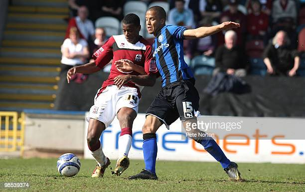 Liam Davis of Northampton Town contests the ball with Joe Thompson of Rochdale during the Coca Cola League Two Match between Rochdale and Northampton...