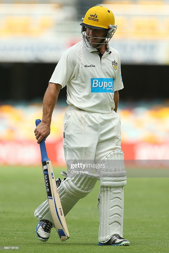 Liam Davis of the warriors leaves the field after being dismissed by Cameron Gannon of the Bulls during day two of the Sheffield Shield match between the Queensland Bulls and the Western Australia Warriors at The Gabba on February 5, 2013 in Brisbane, Australia.