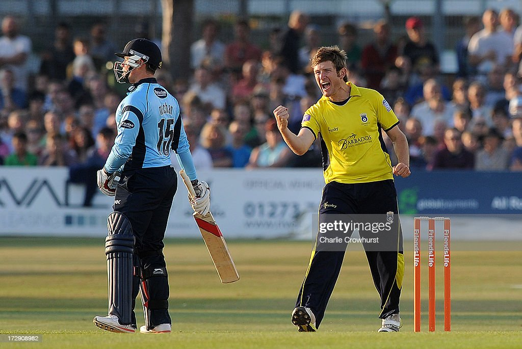 Liam Dawson of Hampshire celebrates after getting the wicket of Dwayne Smith of Sussex during the Friends Life T20 match between Sussex Sharks and Hampshire Royals at The Brighton and Hove Jobs County Ground on July 05, 2013 in Hove, England.