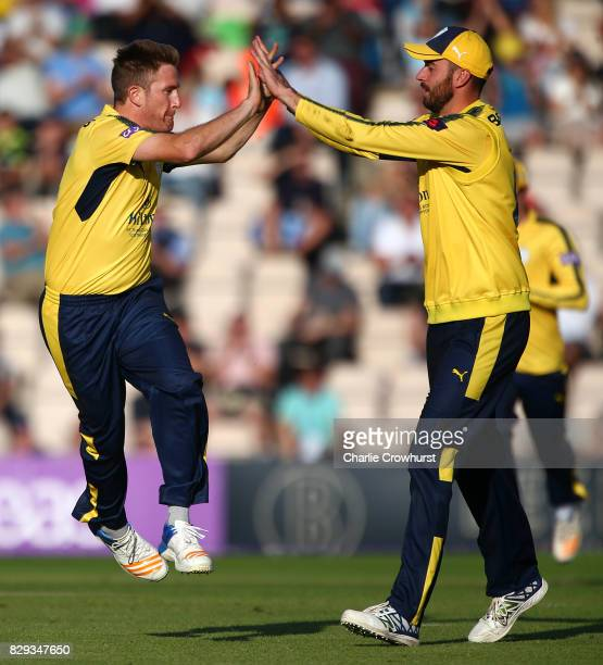 Liam Dawson of Hampshire celebrates with captain James Vince after taking the wicket of Colin Ingram of Glamorgan during the NatWest T20 Blast match...