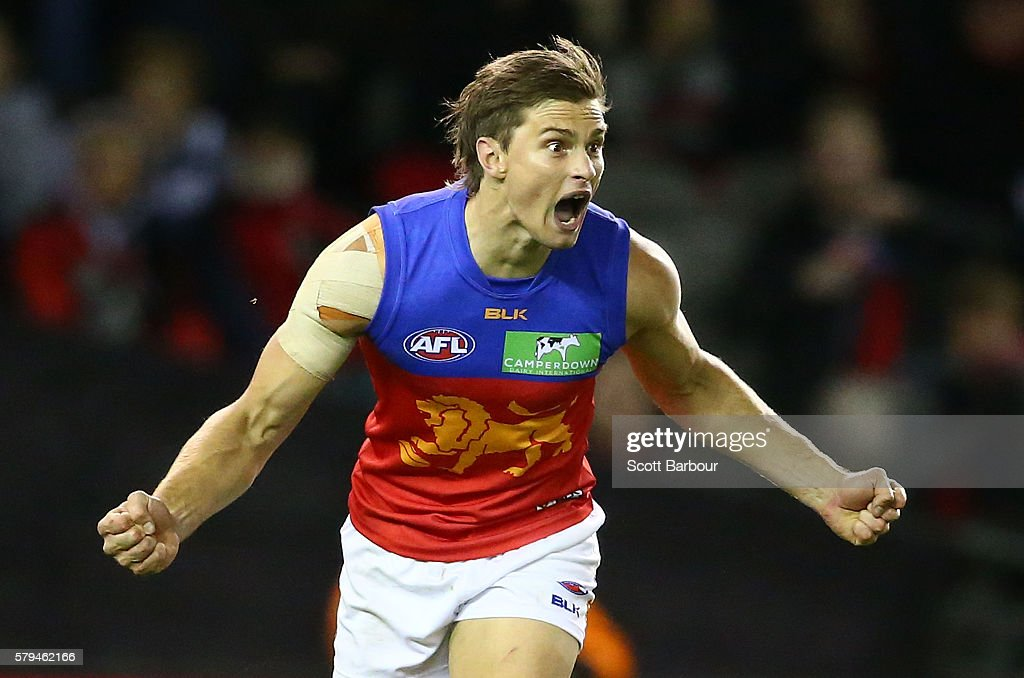 Liam Dawson of the Lions celebrates after kicking a goal during the round 18 AFL match between the Essendon Bombers and the Brisbane Lions at Etihad...