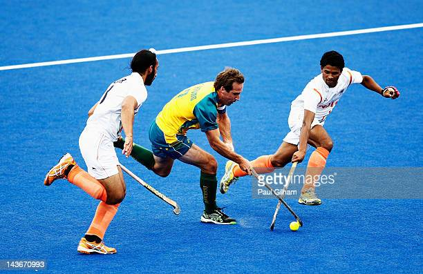 Liam de Young of Australia is tackled by Sardar Singh of India during the Men's preliminary match between Australia and India during the Visa...