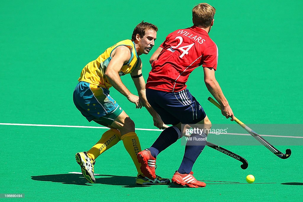Liam De Young of the Kookaburras challenges Ollie Willars of England in the Men's Australia Kookaburras v England game during day three of the 2012 International Super Series at Perth International Hockey Arena on November 24, 2012 in Perth, Australia.