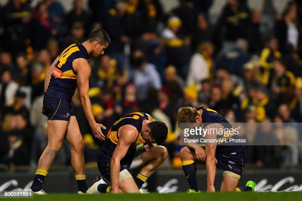 Liam Duggan Luke Shuey and Sam Mitchell of the Eagles react to the loss on the final siren during the 2017 AFL round 14 match between the West Coast...